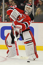 Jan 25, 2013; Newark, NJ, USA; New Jersey Devils goalie Martin Brodeur (30) passes the puck during the second period of their game against the Washington Capitals at the Prudential Center.