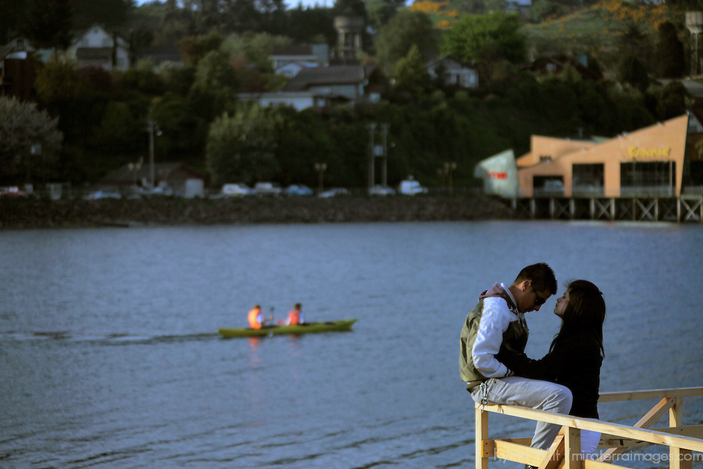 South America, Chile, Puerto Varas. Romantic couple enjoying Llanquihue Lake in Puerto Varas.