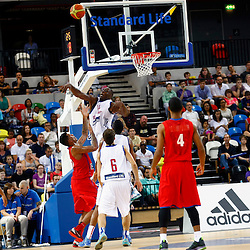 GB men vs Puerto Rico basketball at the Copper Box Arena. Eric Boateng (14) rejects a drive.11/08/2013 (c) MATT BRISTOW