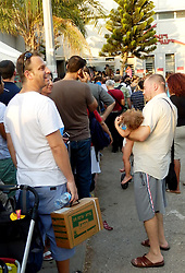 People wait to receive gas-masks in Tel Aviv. <br /> People, some with their old boxed gas-masks, queue to receive new gas-masks or get replacements in a suburb of Tel Aviv as tension mounts over allied military strikes in Syria and Iran threatens Israel if Syria is hit, <br /> Tel Aviv, Israel.<br /> Friday, 30th August 2013. Picture by Max Nash / i-Images