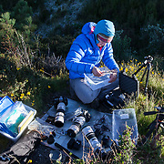 Dr. Stephanie Grocke, a volcanologist, sets up her equipment for photogrammetry, a time-lapse phtoography system she is using to monitor active lava domes.