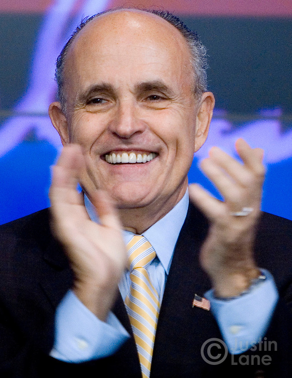US Presidential candidate Rudolph GiulianI claps while ringing the opening bell of the NASDAQ stock exchange in New York, New York on Wednesday 28 March 2007. Following the ringing of the bell, Giuliani held a press conference where Steve Forbes announced that he was endorsing Giuliani's run to be President of the United States.
