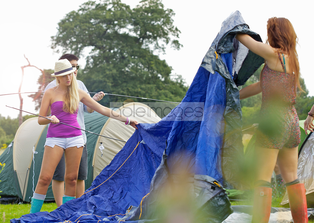 Teenage Girls Erecting Tent