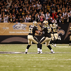 December 12, 2010; New Orleans, LA, USA; New Orleans Saints defensive tackle Sedrick Ellis (98) and linebacker Jonathan Vilma (51) celebrate as cornerback Malcolm Jenkins (27) returns a kickoff for a touchdown during the first half against the St. Louis Rams at the Louisiana Superdome. Mandatory Credit: Derick E. Hingle-US PRESSWIRE