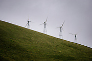 A wind farm in Dublin in the Altamont Pass. The Clean Power Plan, released by the Obama administration August 2015, requires a big shift from fossil fuels to renewable energy to meet the goal of reducing emissions from energy production 32 percent within year 2030. Today, wind energy make roughly five percent of the total energy. The modern windmill can trace its roots back to some students and teachers in Denmark, who came up with the three blade turbine. Denmark was an early adaptor and has now almost 40 percent coming from wind. Wind power has been around for a long time in the US as well, with a steady improvement in technology and grid. The price is down to 2.35 cents per kwh and the wind energy industry now support 73.000 jobs, according to a new report from the US Office of Energy Efficiency and Renewable Energy.