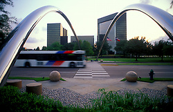 Stock photo of a Houston Metro bus under the chrome arches in the Post Oak Galleria area.
