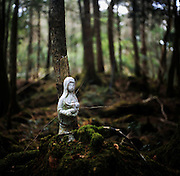 A porcelain figurine of what appears to be Mary holding the baby Jesus is bound to the base of a tree to commemorate someone who committed suicide in Aokigahara Jukai, better known as the Mt. Fuji suicide forest, which is located at the base of Japan's famed mountain west of Tokyo, Japan.