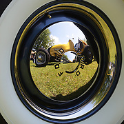 A 1949 Hillegass Sprint Car reflected in the hub cap of a 1950 Ford Custom at the Greenwich Concours d'Elegance Festival of Speed and Style featuring great classic vintage cars. Roger Sherman Baldwin Park, Greenwich, Connecticut, USA.  2nd June 2012. Photo Tim Clayton