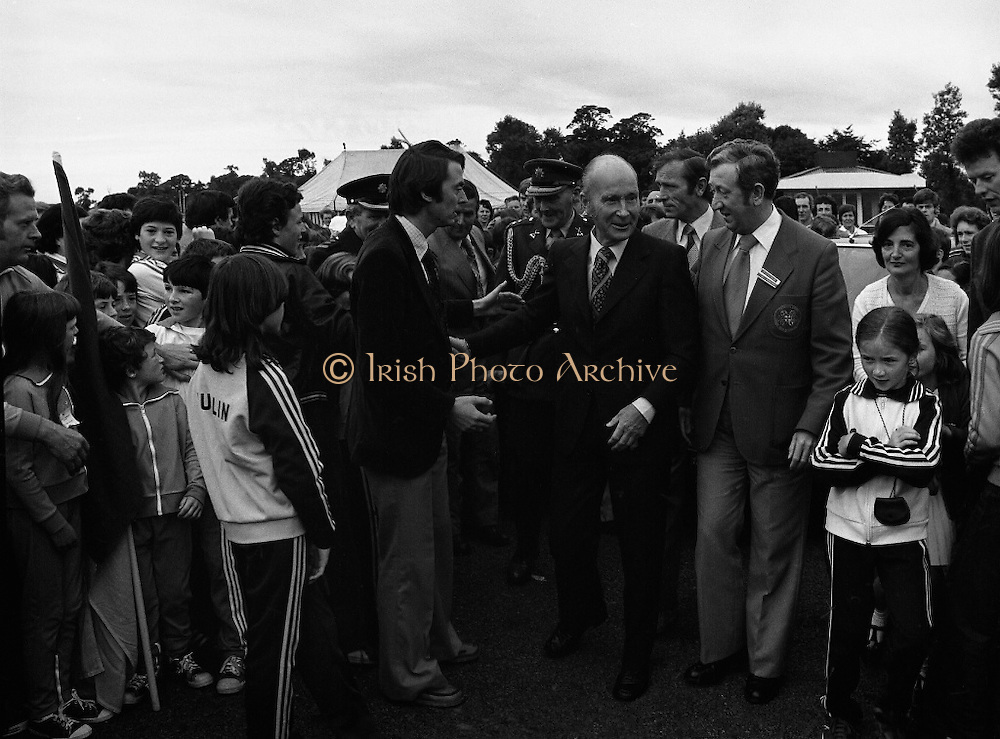 President Hillery at The Community Games..1979..15.09.1979..09.15.1979..15th September 1979..President Patrick Hillery attended the opening of The National Community Games finals at Mosney, Co Meath today. The finals were held in the grounds of The Butlins Holiday Centre and were sponsored by Tayto Irl Ltd,Greencastle Road,Coolock,Dublin..Image shows The President, Dr Partick Hillery, being welcomed to Mosney for the National Community Games by Mr William Walshe,(right) National President,Community Games.