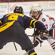 NCAA Men's Hockey: Northeasten Huskies vs. Merrimack Warriors on November 23, 2013 at Matthews Arena in Boston, MA.