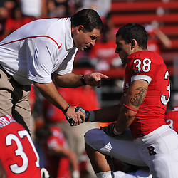 Sep 19, 2009; Piscataway, NJ, USA; Rutgers head coach Greg Schiano speaks to running back Joe Martinek (38) during warmups before the first half of NCAA college football between Rutgers and Florida International at Rutgers Stadium.