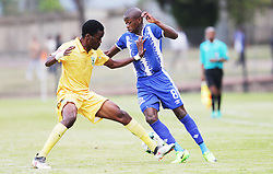 13052018 (Durban) Siphoesihle Ndlovu tackle with Danny Phiri at a Final match of the ABSA premier league between Maritzburg United and Lamontville Golden Arrows at The Harry Gwala stadium, Yesterday.<br /> Pictcure: Motshwari Mofokeng/ANA