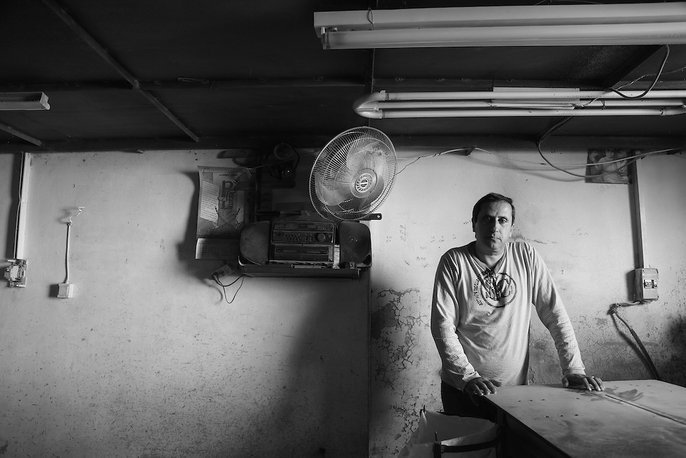 The well-documented emigration of Palestinian Christians is caused by political instability and economic pressure according to Ibrahim Odeh who is himself a Christian and also manager of the Odeh olive wood factory in Beit Sahour: &quot;200 people from Beit Sahour used to work in the casino in Jericho that closed during the intifada, others worked in Jerusalem. All that work has gone now. Those people either went in to the olive wood industry or emigrated. If a man cannot provide for his family what can he do?&quot;.<br /> <br /> Ibrahim Odeh - Beit Sahour, Bethlehem, Palestine. 6/12/2014
