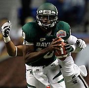 Baylor's Robert Griffin III is tackled from behind by Washington's Josh Shirley during game action of the 2011 Valero Alamo Bowl at the Alamodome in San Antonio, Texas on Thursday, Dec. 29, 2011. Baylor won 67-56.