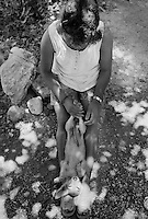 Girl Playing with dog, Chetumal, Mexico