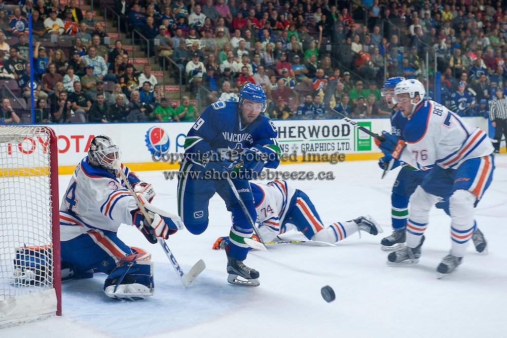 PENTICTON, CANADA - SEPTEMBER 16: Nick Ellis #34 of Edmonton Oilers deflects a shot by Danny Moynihan #79 of Vancouver Canucks on September 16, 2016 at the South Okanagan Event Centre in Penticton, British Columbia, Canada.  (Photo by Marissa Baecker/Shoot the Breeze)  *** Local Caption *** Danny Moynihan; Nick Ellis;
