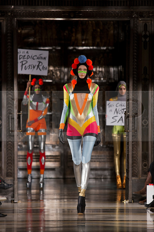 """© Licensed to London News Pictures. 14 February 2014, London, England, UK. Pam Hogg's """"Pussy Riot Collection"""" at London Fashion Week. A model walks the runway at the Pam Hogg show during London Fashion Week AW14 at Fashion Scout/Freemasons' Hall. Photo credit: Bettina Strenske/LNP"""