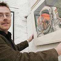Tim Humphries from Tulla puts the finishing touches to his piece 'Spaceman, evening prayer' at the Clare Printmakers exhibition in the Russell Gallery in New Quay on Saturday evening.<br /> <br /> Photograph by Yvonne Vaughan.