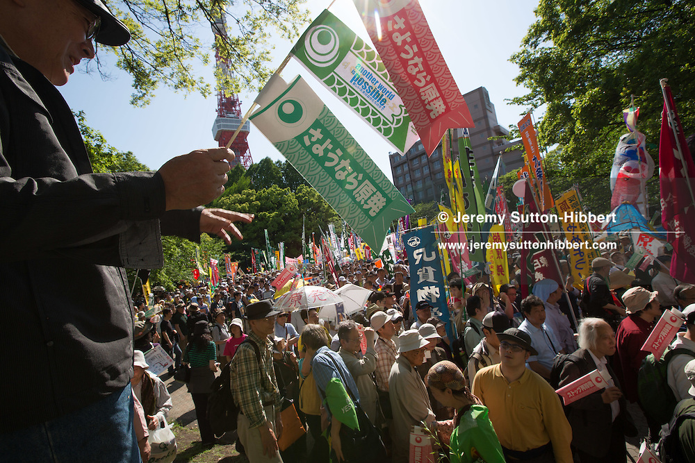 Protestors on the 'Goodbye to Nuclear Power Plants' rally parade through the streets of Tokyo on the day that the last of Japan's 54 nuclear reactors is taken offline, leaving the country temporarily nuclear-free, in Tokyo, Japan on Sunday 29th April 2012.
