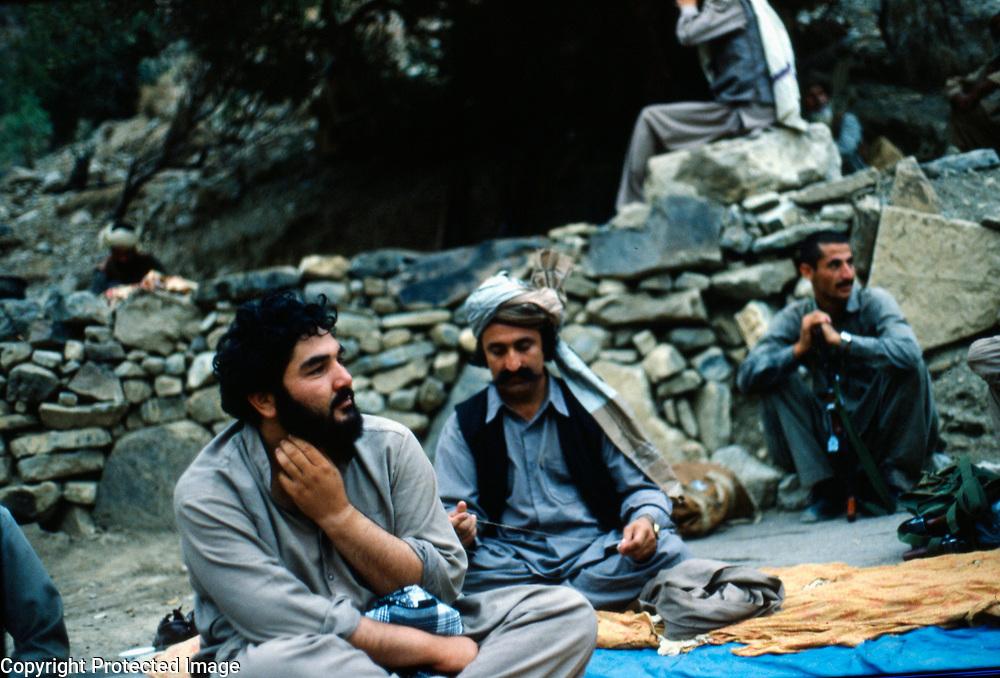 26 July 1985 <br /> Waiting for breakfast. Akbarzai on left; Babrakzai on right. Akbarzai is one of Pir Gailani's most trusted lieutenants.