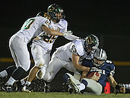 Cedar Rapids Xavier Quinton Scholer (9) is sacked by Cedar Rapids Kennedy's Austin Holzer (53) as Cody Burke (20) and Killian Magee (95) look on in the Class 4A quarterfinal playoff game at Saints Field in Cedar Rapids on Friday, November 8, 2013.