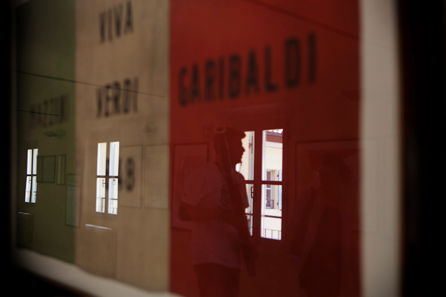 Students in the halls of the Higher Institute of Music 'Achille Peri' in Reggio Emilia which hosts a permanent historical Italian flag exhibition.