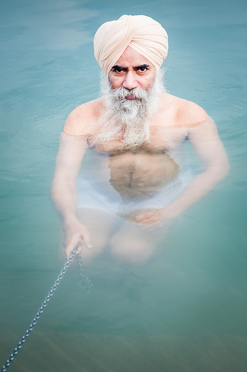 Sikh man bathing in Golden Temple