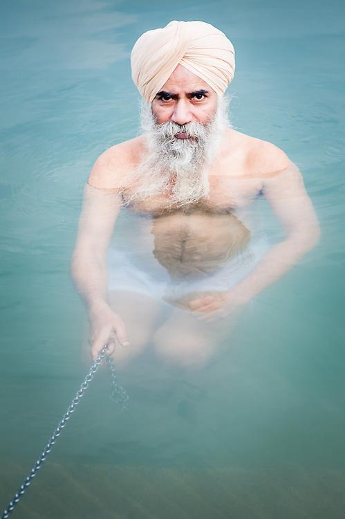 Sikh man bathing in Golden Temple