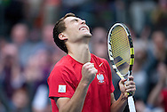 Jerzy Janowicz of Poland reacts after winning ball at single match during third day of the BNP Paribas Davis Cup 2013 between Poland and South Africa at MOSiR Hall in Zielona Gora on April 07, 2013...Poland, Zielona Gora, April 07, 2013..Picture also available in RAW (NEF) or TIFF format on special request...For editorial use only. Any commercial or promotional use requires permission...Photo by © Adam Nurkiewicz / Mediasport