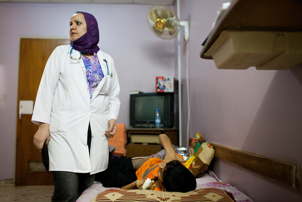A nurse tends to a young cancer patient at a hospital in Medical City on Sunday, October 24, 2010 in Baghdad, Iraq.