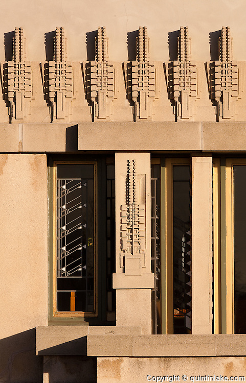 Western facade and window detail with cast concrete Hollyhock motif. The Aline Barnsdall Hollyhock House, East Hollywood, Los Angeles, California USA designed by architect Frank Lloyd Wright 1919-1921