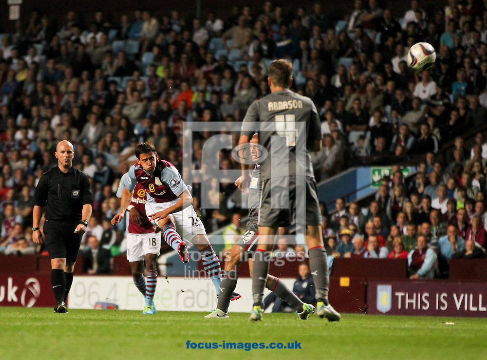 Picture by Tom Smith/Focus Images Ltd 07545141164<br /> 28/08/2013<br /> Aleksander Tonev (centre) of Aston Villa takes a shot during the Capital One Cup match at Villa Park, Birmingham.