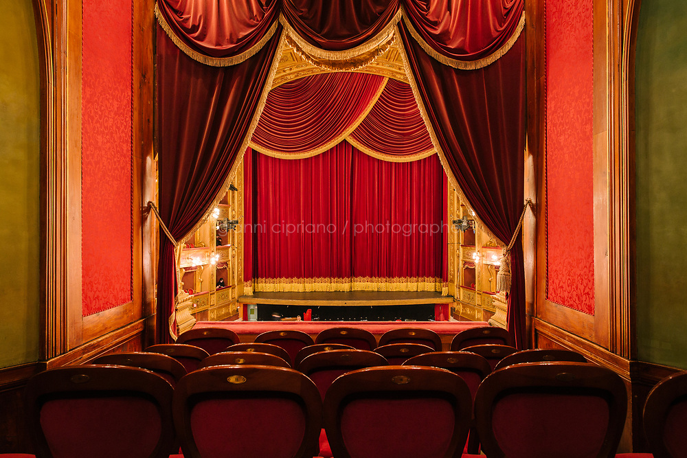 PALERMO, ITALY - 18 FEBRUARY 2018: A view of the auditorium and the stage are seen here from the Royal Box at the Teatro Massimo in Palermo, Italy, on February 18th 2018.<br /> <br /> The Teatro Massimo Vittorio Emanuele is an opera house and opera company located  in Palermo, Sicily. It was dedicated to King Victor Emanuel II. It is the biggest in Italy, and one of the largest of Europe (the third after the Op&eacute;ra National de Paris and the K. K. Hof-Opernhaus in Vienna), renowned for its perfect acoustics. It was inaugurated in 1897.