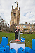 Lord John McFall. Marking World Water Day, over 40 MP's walked for water at Westminster, London at an event organised by WaterAid and Tearfund. Globally hundreds of thousands of people took part in the campaign to raise awareness of the world water crisis.