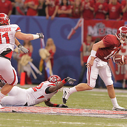 2 January 2009: Alabama quarterback John Parker Wilson (14) escapes from Utah cornerback Joe Dale (12) during the 75th annual All State Sugar Bowl  between the Utah Utes and the Alabama Crimson Tide at the Louisiana Superdome in New Orleans, LA.