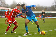 Grimsby Town forward Mallik Wilks (18) tries to keep the ball from Crawley Town midfielder Jimmy Smith (8) during the EFL Sky Bet League 2 match between Crawley Town and Grimsby Town FC at the Checkatrade.com Stadium, Crawley, England on 10 February 2018. Picture by Andy Walter.