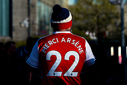 An Arsenal fans wears a 'Merci Arsene' shirt in homage to outgoing Arsenal manager Arsene Wenger - Mandatory by-line: Robbie Stephenson/JMP - 26/04/2018 - FOOTBALL - Emirates Stadium - London, England - Arsenal v Atletico Madrid - UEFA Europa League Semi Final 1st Leg