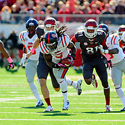 Mississippi defensive back Charles Sawyer (3) returns a blocked Arkansas punt during an NCAA college football game in Little Rock, Ark., Saturday, Oct. 27, 2012. (Photo/Thomas Graning)