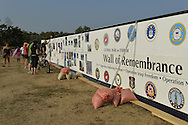 """East Meadow, New York, U.S. 11th September 2013. Young and old visitors visit the Global War on Terror """"Wall of Remembrance"""" a traveling memorial on display in New York for the first time, at Eisenhower Park on the 12th Anniversary of the terrorist attacks of 9/11. The unique 94 feet long by 6 feet high wall has, on one side, almost 11,000 names of those lost on September 11, 2001, along with heroes and veterans who lost their lives defending freedom of Americans over past 30 years. On the wall's other side is a timeline, with photos, covering 1983 to present day."""