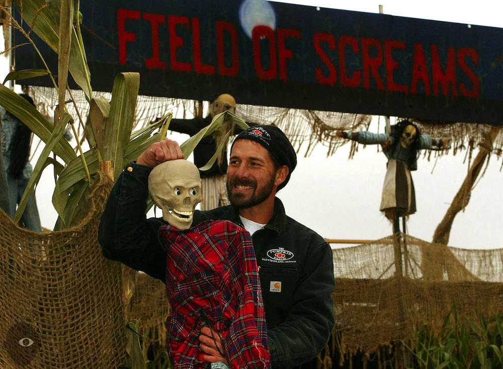 Craig Easterly hangs out with one of many characters he employs within the Field of Screams, the haunted corn maze he operates at the Pumpkin Patch on Sauvie Island..