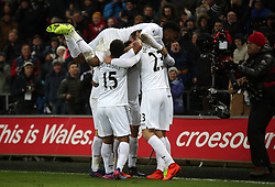 Swansea City's Martin Olsson (obscured) celebrates scoring his side's second goal of the game during the Premier League match at the Liberty Stadium, Swansea.