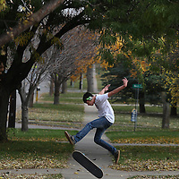 Julian Lewis, 15, does a trick while skateboarding along 22nd Street near Glendale Ave. in Sioux Falls, S.D.