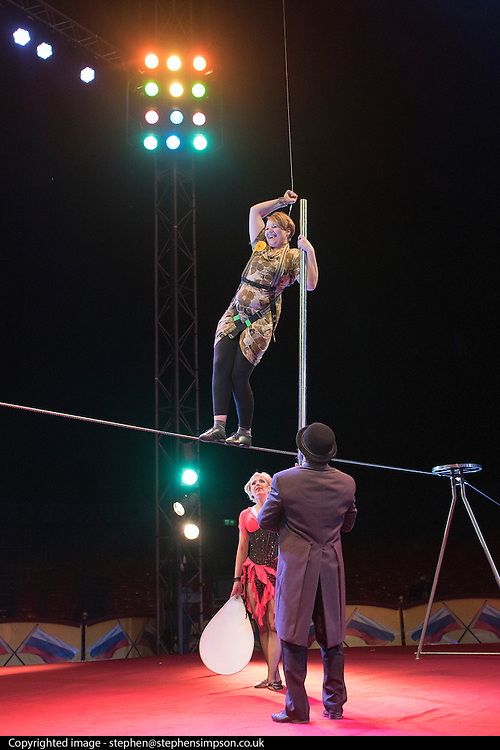 © Licensed to London News Pictures. 22/04/2015. Guildford, UK. Kelly Maire Blunder takes a tumble as she is guided through the process by comedy artist Vladimir Georgieski and high wire walker Olga Roxhkovskaya. Liberal Democrat Kelly-Marie Blundell walks the high wire at Moscow State Circus in Guildford. Photo credit : Stephen Simpson/LNP