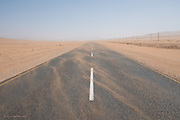 Never seen anything like it. We were on the road to wind blown Atlantic coastal town of Luderitz and a few miles before we arrived the effects of the wind could already be seen. At some points you could hardly see in front of the car and at other sand drifts had built across the road. I stepped out of the car on this near deserted road and was instantly sand-blasted by stinging grains of fast-blown crystals. I was amazed that there was even a road as the sand blew so constantly across the landscape.