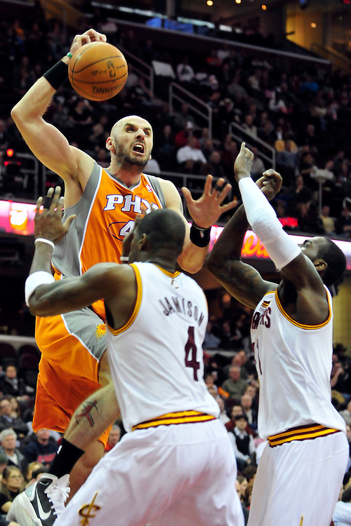 Jan. 19, 2011; Cleveland, OH, USA; Phoenix Suns center Marcin Gortat (4) drives into Cleveland Cavaliers power forward Antawn Jamison (4) and power forward J.J. Hickson (21) during the second at Quicken Loans Arena. Mandatory Credit: Jason Miller-US PRESSWIRE
