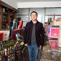 Hunan, Liuyang, Dec. 19..2013 : Manager Ma  poses for a portrait in the showroom of his company.