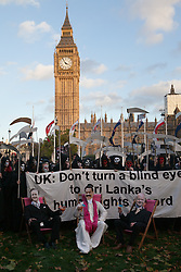 Hundreds of Amnesty supporters dressed as grim reapers and also dressed as the Prime Minister David Cameron and Foreign Secretary William Hague lookalikes gather in Parliament Square, Westminster to protest UK government endorsement of Sri Lanka at next week's meeting of Commonwealth Heads of Government Meeting (CHOGM) in Colombo. Saturday November 2, 2013. Photo by Daniel Leal-Olivas