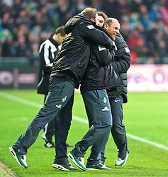 14.02.2015, Weserstadion, Bremen, GER, 1. FBL, SV Werder Bremen vs FC Augsburg, 21. Runde, im Bild Viktor Skripnik (Cheftrainer SV Werder Bremen) beim Jubel nach dem Abpfiff, hier umarmt von Florian Kohfeldt (Co-Trainer SV Werder Bremen), Torsten Frings (Co-Trainer SV Werder Bremen) im Hintergrund // during the German Bundesliga 21th round match between SV Werder Bremen and FC Augsburg at the Weserstadion in Bremen, Germany on 2015/02/14. EXPA Pictures © 2015, PhotoCredit: EXPA/ Andreas Gumz<br /> <br /> *****ATTENTION - OUT of GER*****