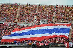 BANGKOK, THAILAND - Sunday, July 28, 2013: Liverpool supporters unfurl a huge Thailand flag before a preseason friendly match at the Rajamangala National Stadium. (Pic by David Rawcliffe/Propaganda)