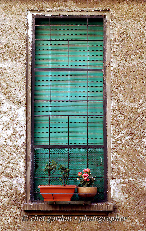 Flowers bloom in a window box at an apartment building in Milan, Italy in March 2002.
